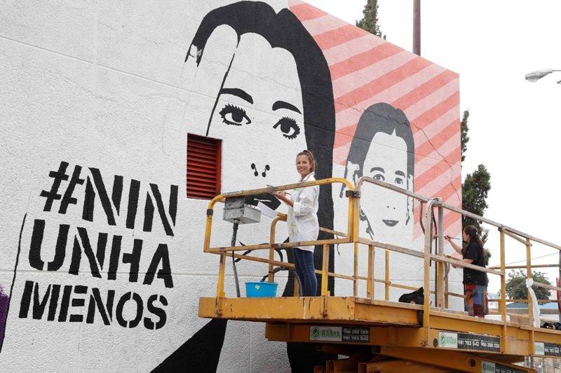 Compromiso y arte contra el maltrato en una medianera - Vigo ...
